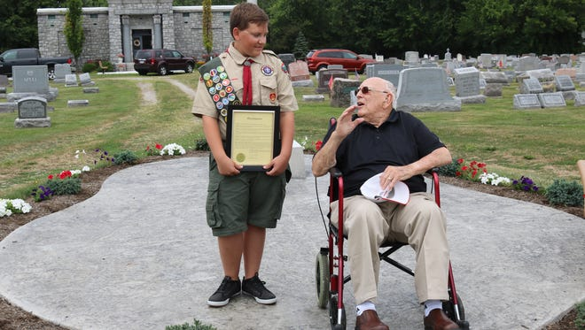 As he became the latest local Eagle Scout, Jayce Kennedy, 15, left, was joined and congratulated Monday by Ottawa County's second scout ever to reach that rank, Darrell Hablitzel, 99.