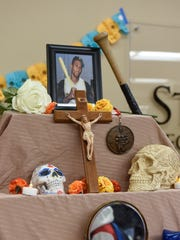A shrine to baseball player Roberto Clemente is on display during a Dia de los Muertos and Halloween Bash Tuesday, Oct. 31, at St. Cloud Technical & Community College in St. Cloud.