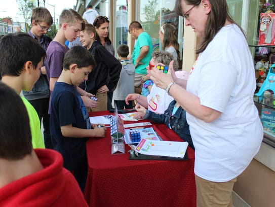 Visitors gather for the Rubik's Cube Competition held
