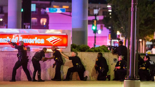 Dallas Police respond after shots were fired at a Black Lives Matter rally in downtown Dallas Thursday.