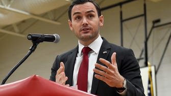 "Wisconsin 8th District Congressman Mike Gallagher delivered the keynote speech honoring the late U.S. Army Col. Tim Lawrie and his family. Gallagher, a U.S. Marine veteran, concluded his speech ""When we look on our own lives, to be able to say that we did everything we possibly could to make sure that our flag still waves over a free land of great people.''