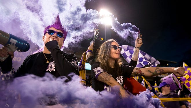 Louisville City FC fans cheer on their team in a game against St. Louis FC.May 14, 2016