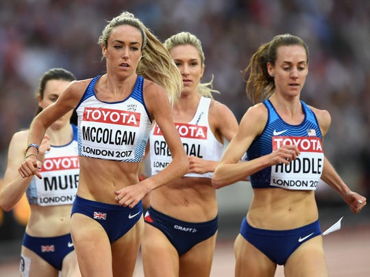 Eilish McColgan of Great Britain, left, and Molly Huddle run in the 5,000 finals Sunday at the IAAF World Championships at Olympic Stadium in London.