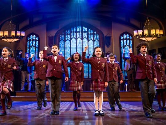 "The children's ensemble of ""School of Rock."""