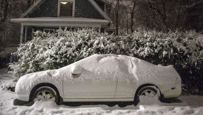 Snow falls heavily in West Asheville early Thursday.