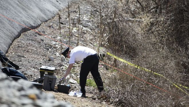 Police investigate an Irondequoit site where human remains were found April 19. On Tuesday, April 28, new remains were found during the ongoing police investigation.