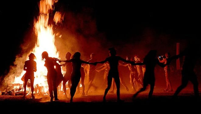 Burners dance around flames during the 1997 event held on Fly Ranch, just north of the Black Rock Desert playa.