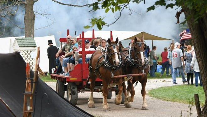 Visitors enjoy a wagon ride at Malabar Farm during Heritage Days in 2017.