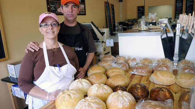 Neva and Mike Austin at their deli and bakery, Aggie Mae's, in Grand Ledge on Thursday.