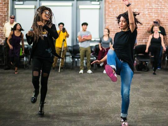 Street-dance activist Shamell Bell has ASU faculty fellow Chandra Crudup try a dance move.