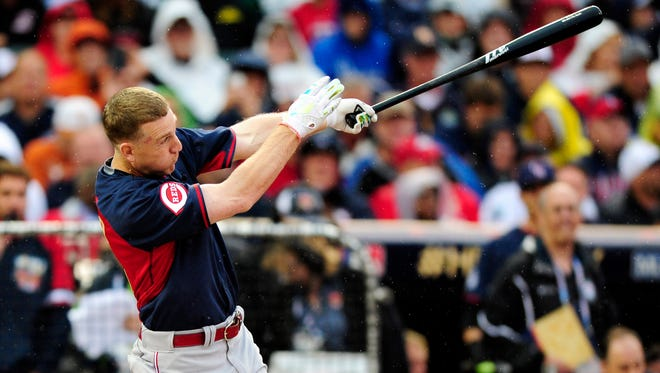 National League infielder Todd Frazier (21) of the Cincinnati Reds at bat in the first round during the 2014 Home Run Derby the day before the MLB All Star Game at Target Field.