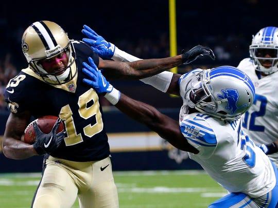 Saints receiver Ted Ginn stiff-arms Lions cornerback DJ Hayden in the first half in New Orleans, Sunday, Oct. 15, 2017.