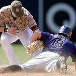 Padres second baseman Cory Spangenberg, left, and the Rockies' Michael McKenry (8) become entangled after McKenry was caught stealing second during the seventh inning of their game Sunday in San Diego.