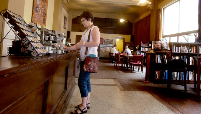 A woman stops in for coffee at 'The Vault', a self-serve coffee shop in downtown Valley City, N.D.