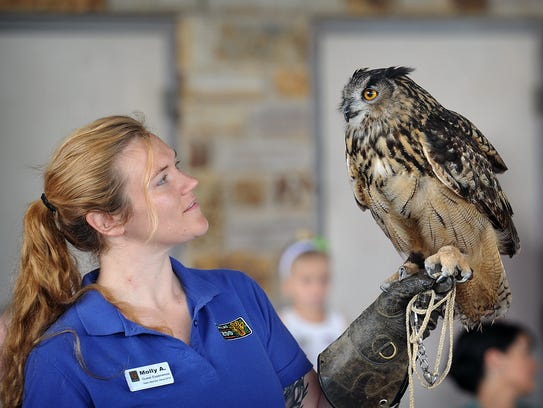 Molly Andrews of the Dallas Zoo holds Kruger, a Eurasian