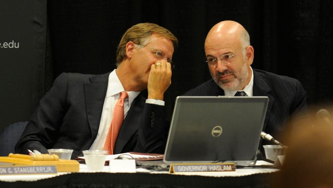 Gov. Bill Haslam, left, talks with UT President Joe DiPietro during a board of trustees meeting Thursday, June 21, 2012 at the University of Tennessee. Trustees voted on the annual budget and an 8 percent tuition increase in Knoxville to cover fixed costs, salary increases and academic initiatives.