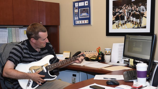 Elliot Bloom, Purdue's director of basketball operations, keeps an electric guitar in his office so he can play Tom Petty songs.