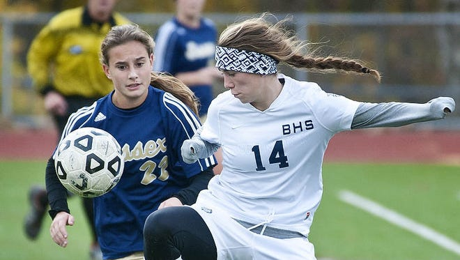 Burlington's Abigail Feeney (right) and Essex's Jessica Poratti close in on the ball in Burlington on Wednesday, October 30,  2013.