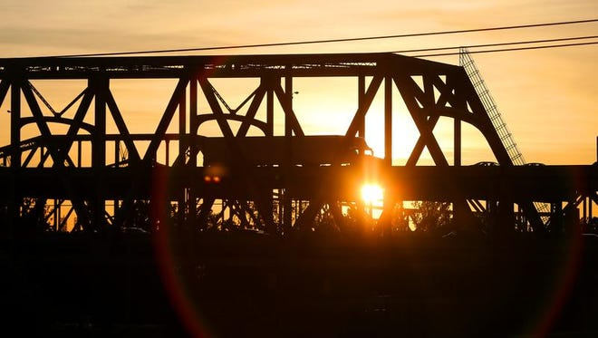 The sun rises over the Brent Spence Bridge on Friday.
