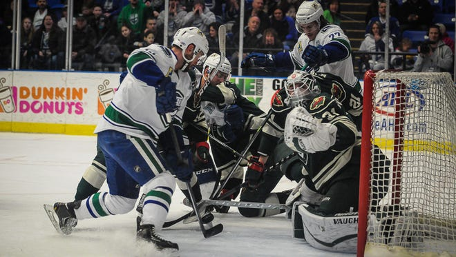 Iowa goalie Johan Gustafsson makes a first period save on Utica forward Colin Stuart. Gustafsson made 21 saves in the Wild's 3-2 defeat on the road.