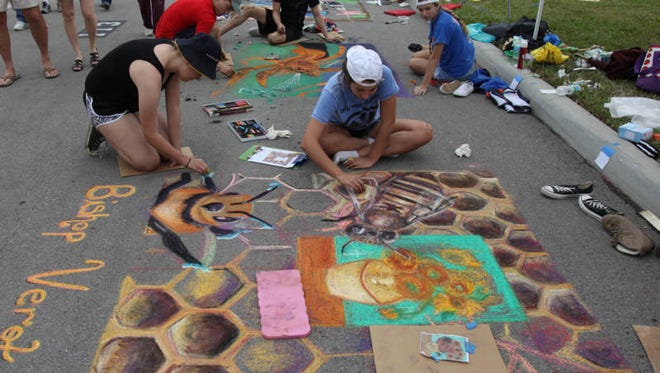 Visitors to downtown Fort Myers attend  the 14th annual Artfest Fort Myers on Saturday.