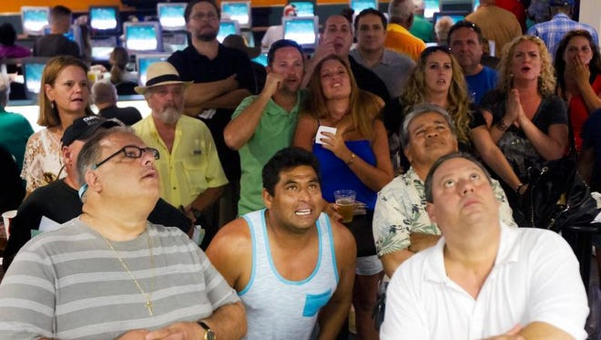 Horse racing fans watch the Belmont Stakes on Saturday at the Naples-Fort Myers Greyhound Track in Bonita Springs. Tonalist upset California Chrome in the race.