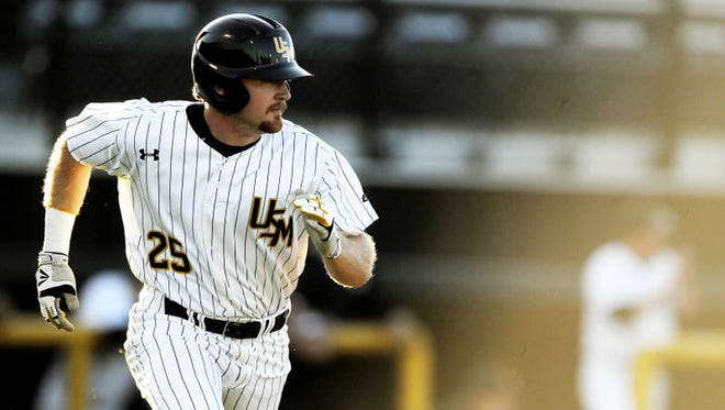University of Southern Mississippi's Mason Robbins gets a base hit during their game against Rice University Friday afternoon at USM's Pete Taylor Park.