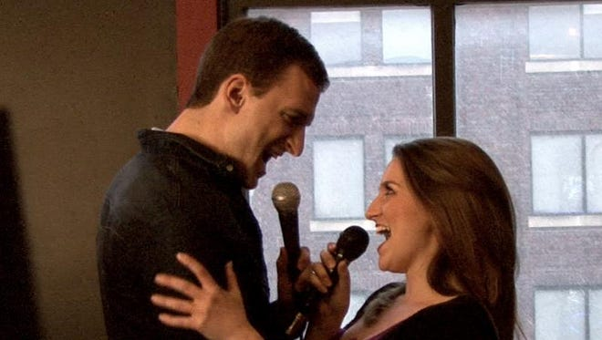 """Steven Grant Douglas and Andrea Rouch, who play Sam and Molly in """"Ghost The Musical,"""" sing """"Here Right Now."""""""