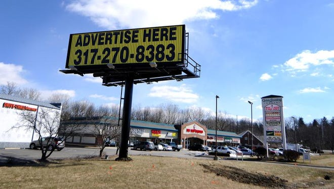 """A large """"Advertise Here"""" billboard sits at the corner of 79th Street and Fall Creek Road, Thursday, February 27, 2014, in Indianapolis. Geist residents didn't know the sign was coming and want it removed."""
