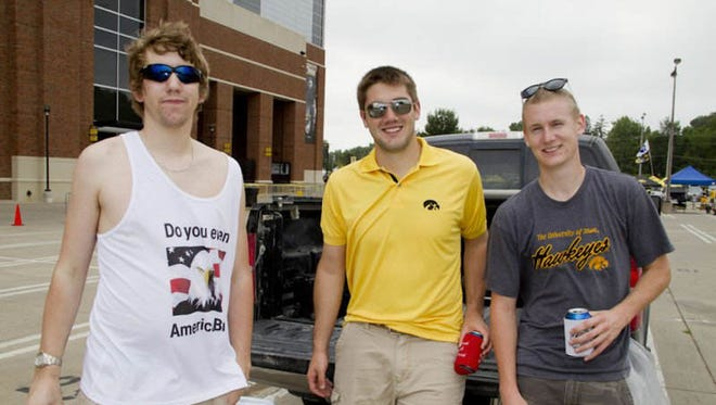 Hawkeye fans tailgate before the Iowa-Northern Illinois game at Kinnick Stadium on Saturday, Aug. 31, 2013.