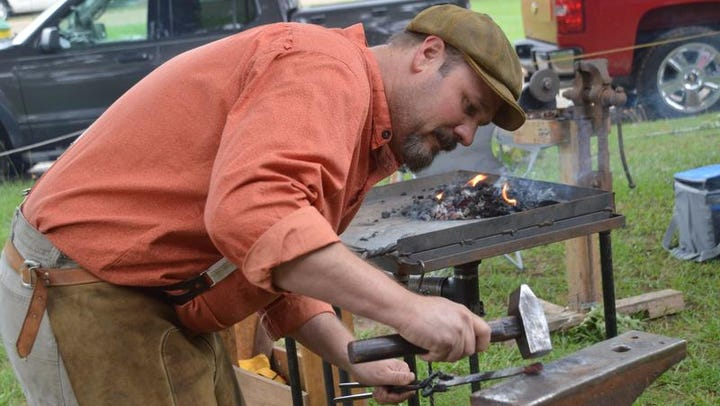 ANI NSU Folk Festival Chad Manning, a member of the Red River Smiths, designs items as he blacksmiths for visitors at the Natchitoches Folk Festival held Saturday, July 19, 2014 at Prather Coliseum on the NSU campus.