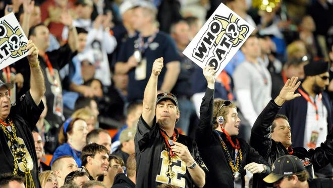 """FILE -- Saints fans show the """"Who Dat?"""" theme that became the rallying cry for the team and helped unify supporters of the Black and Gold."""