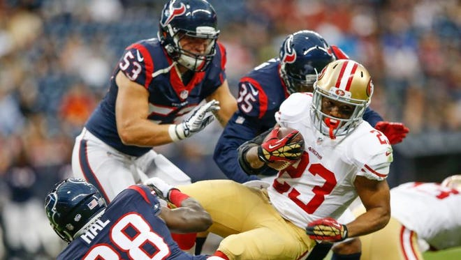 Texans rookie linebacker Max Bullough (53) is in on a tackle of 49ers running back LaMichael James during the first quarter Thursday.