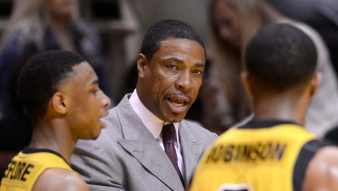 Alabama State's Coach Lewis Jackson talks with players during their game with Jackson State on Saturday, March 8, 2014, in Montgomery, Ala.