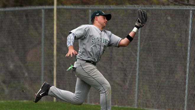 South Plainfield traveled to Monroe for a varsity baseball game vs. Monroe High School.   South Plainfield's # 25-Nick Polizzano makes the catch of a pop up hit by Monroe's # 4-Willie Levier. (not seen).