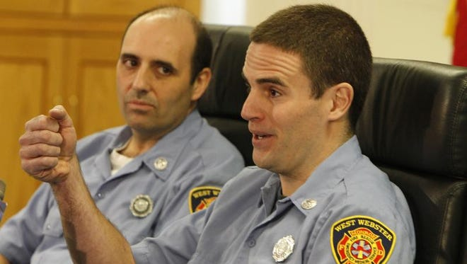 A March 6 file photo of Joseph Hofstetter, right, and Ted Scardino talking about the Christmas Eve shooting.