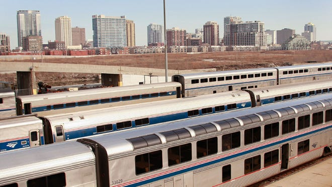Amtrak cars sit in a rail yard on the southern edge of downtown Chicago, Illinois.