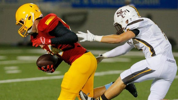 Palma's Liam McMillin runs past St. Francis' Jonathan Figone in their week 2 football game on Friday, Sept. 12, 2014 at Rabobank Stadium in Salinas.