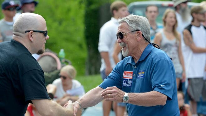 Del. Dickie Bell, R-Staunton, shakes hands with someone in the crowd during the parade. America's Birthday Celebration held its annual parade in Gypsy Hill Park on Thursday, July 4, 2013.