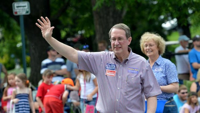 U.S. Rep. Bob Goodlatte, R-6th, waves to the crowd as he walks in the parade. America's Birthday Celebration held its annual parade in Gypsy Hill Park on Thursday, July 4, 2013.