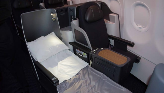 A business-class seat – reclined into its flat-bed mode – inside American's new Airbus A321 aircraft.