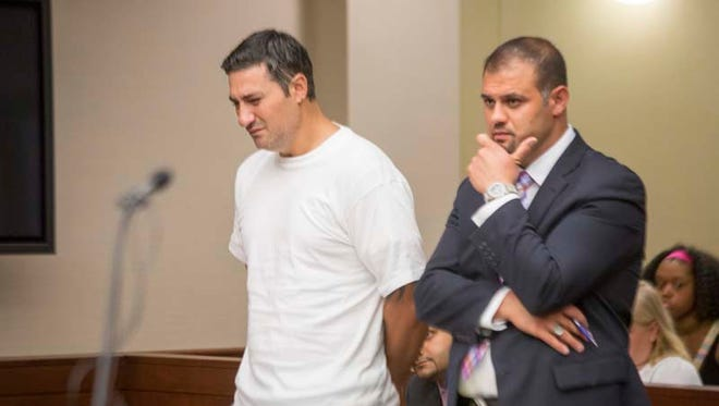 Bassel Saad, left, weeps silently as he is charged with second-degree murder on July 10 in the death of a soccer referee. With Saad is defense attorney Ali Hammoud.