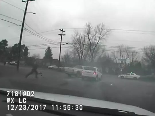 Surveillance video shows a patrol car being hit by