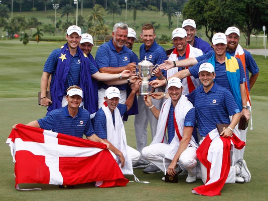 Members of Team Europe, top row left to right, Danny Willet of England, Andy Sullivan of England, Darren Clarke of Northern Ireland, Victor Dubuisson of France, Ian Poulter of England, Lee Westwood of England, Ross Fisher of England, Kristoffer Broberg of Sweden, Shane Lowry of Ireland, front row left to right, Soren Kjeldsen of Denmark, Matthew Fitzpatrick of England, Chris Wood of England and Bernd Wiesberger of Austria, pose for photos with their trophy after winning the Eurasia Cup golf tournament at the Glenmarie Golf and Country Club in Subang, Malaysia, Sunday, Jan. 17, 2016. (AP Photo/Joshua Paul)