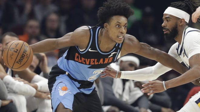 Cleveland Cavaliers guard Collin Sexton, left, drives past the Utah Jazz's Mike Conley in the first half of a game on March 2 in Cleveland.