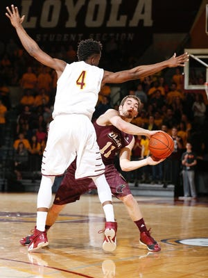 ULM's Nick Coppola looks to make a pass against Loyola-Chicago on Monday.