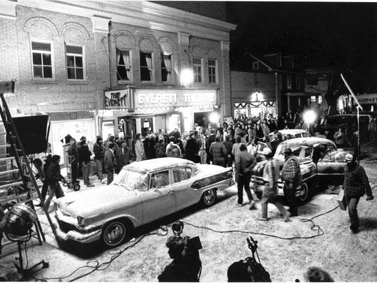 "Filmmakers shoot a ""Dead Poets Society"" scene outside Middletown's Everett Theatre in December 1988. The ""snow"" on the ground was created with crushed marble and limestone. Sidewalks and trees were sprayed with soap."