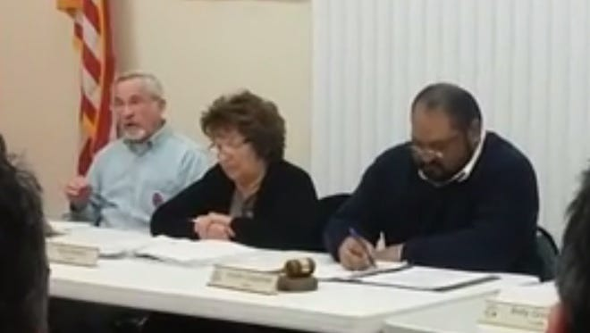 Anthony, N.M., Trustee James Scott expresses concerns at a Wednesday night meeting about campaign signs being abruptly taken down by city staff throughout the city this week. Trustee Pilar Madrid and Mayor Arnulfo Casteñeda also are seen.