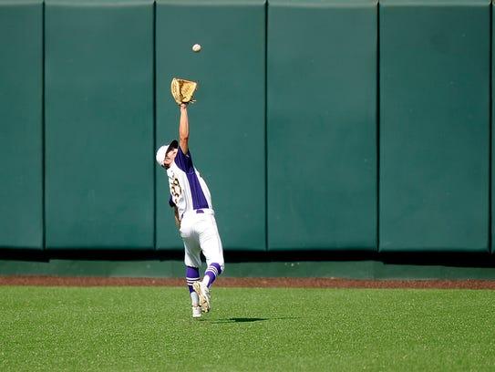 Wylie center fielder Sam King (33) runs down a fly