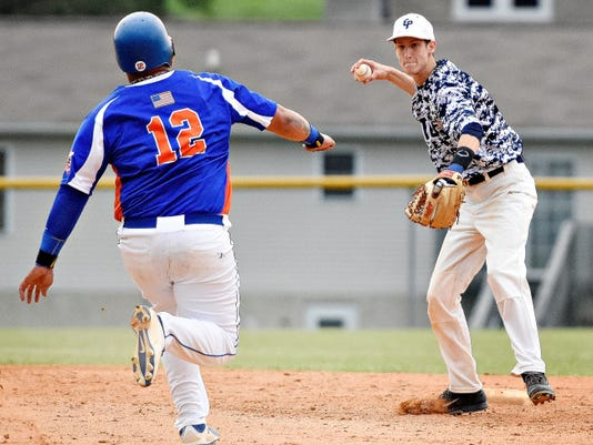 East Prospect's Ryan Saxman, right, throws to first after forcing out Hallam's Angel Matias at second base during Susquehanna League baseball action in East Prospect on Tuesday. East Prospect won the game, 2-0.